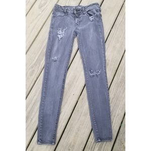 American Eagle Outfitters Jeans - Aeo Low-rise Super Strech Distressed Jeggings